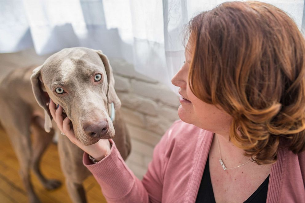 Lindsey with her dog Doug a Weimaraner she rescued from the Pennsylvania SPCA