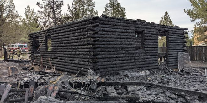 Dog awakens Crooked River Ranch resident who escapes fire that destroyed log home